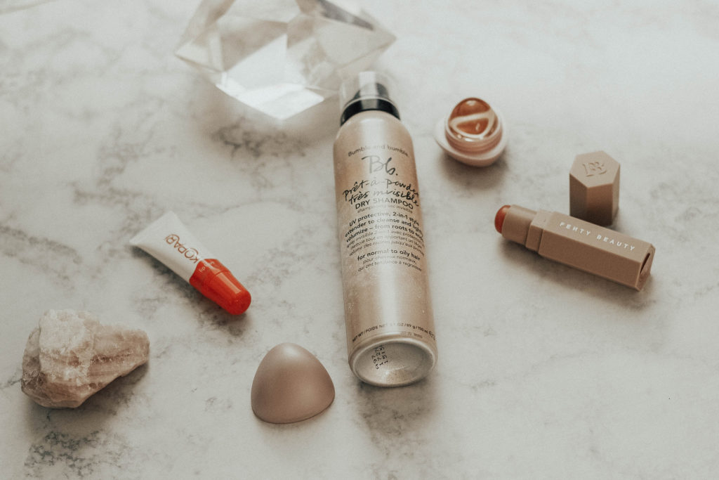 What's In My Makeup Bag (January): Fenty Beauty Matchstix in Yacht Lyfe, EOS Crystal in Pink Hibiscus, Kopari Coconut Lip Glossy, and Bumble & Bumble Pret-a-Powder Tres Invisible dry shampoo